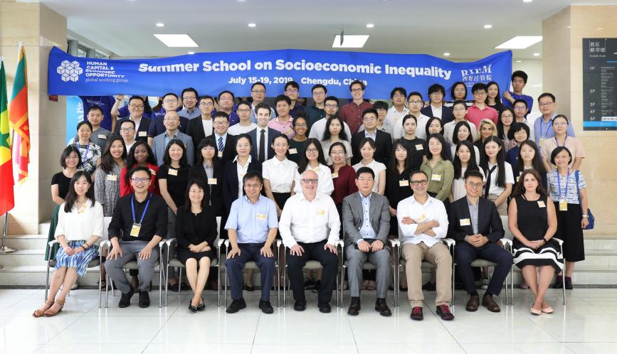 A group photo of all the students and faculty at the Summer School.