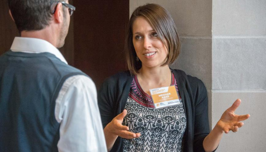 Meghan Azad in conversation with another conference attendee.