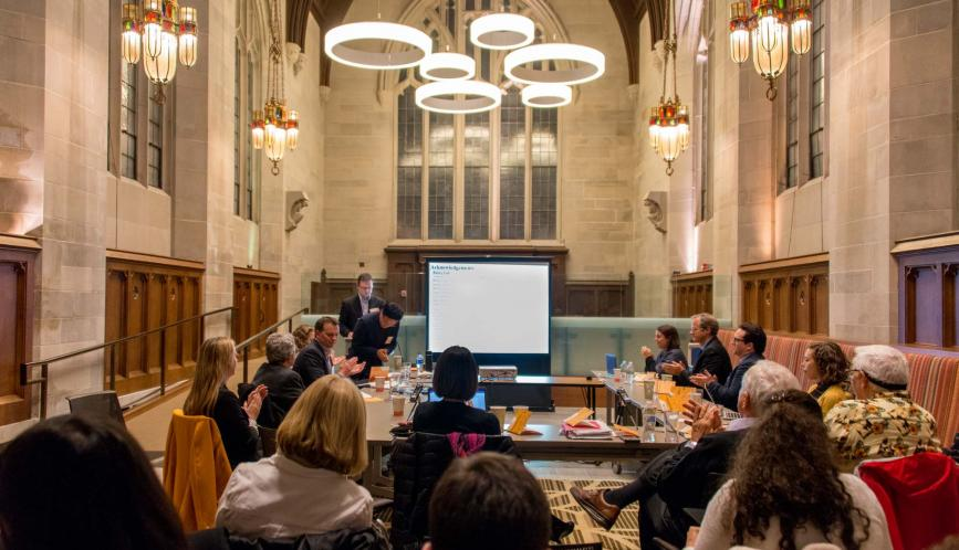 A wide shot of the conference, which took place in the graduate student lounge in Saieh Hall at the University of Chicago.
