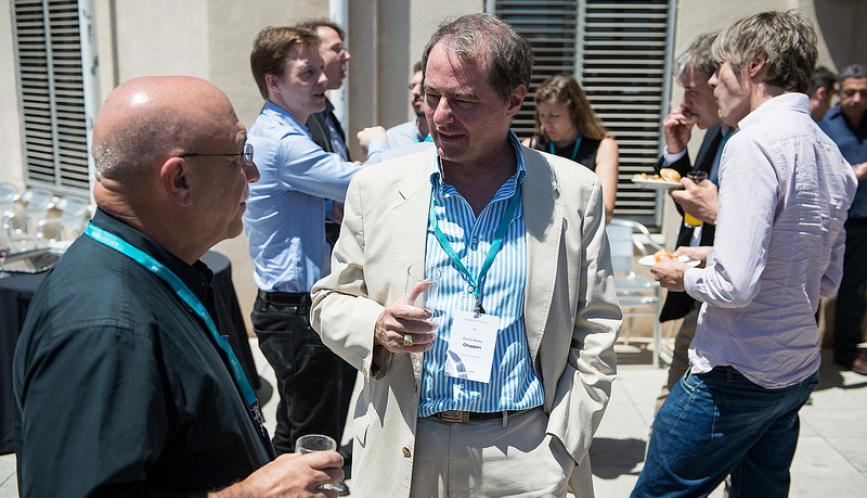 Pierre-Andre Chiappori outside speaking to other conference attendees.