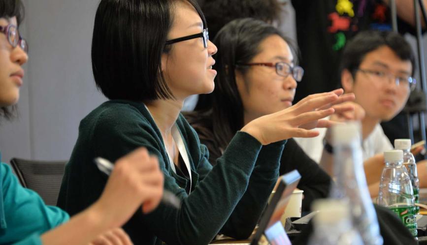 A participant asks a question of the lecturer.