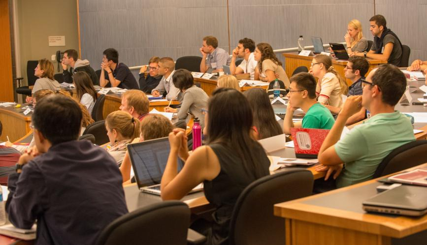 A classroom of summer school students watching a presentation.