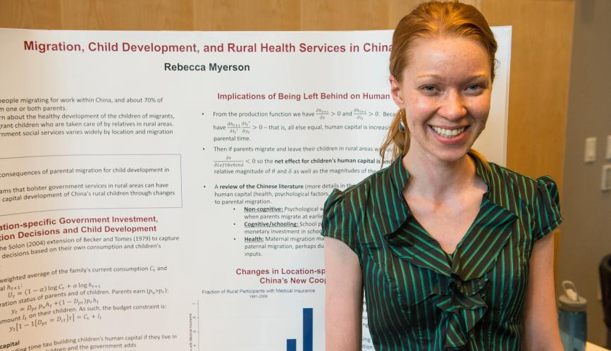 Rebecca Myerson in front of her poster.