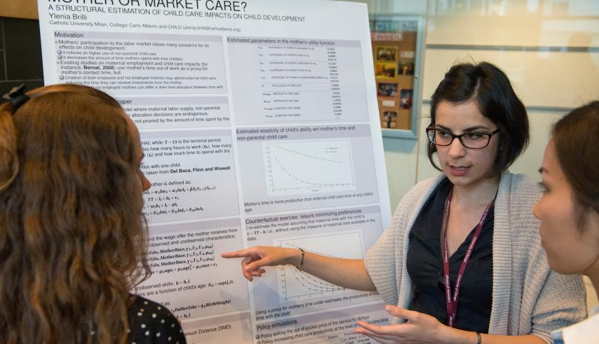 A student presents her work during poster sessions.