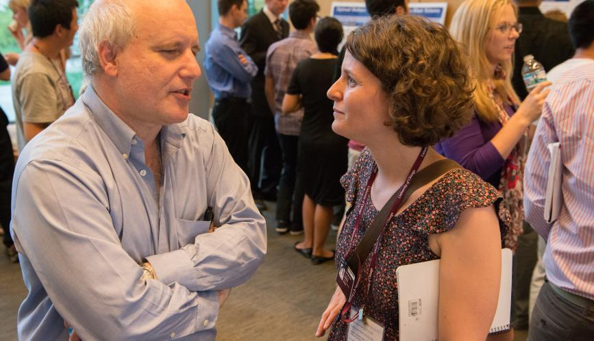 Steven Durlauf in conversation with a student during poster sessions.