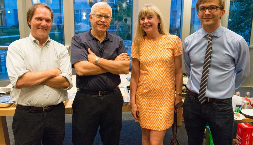 Chris Taber, James Heckman, Petra Todd, and John Eric Humphries standing and smiling.