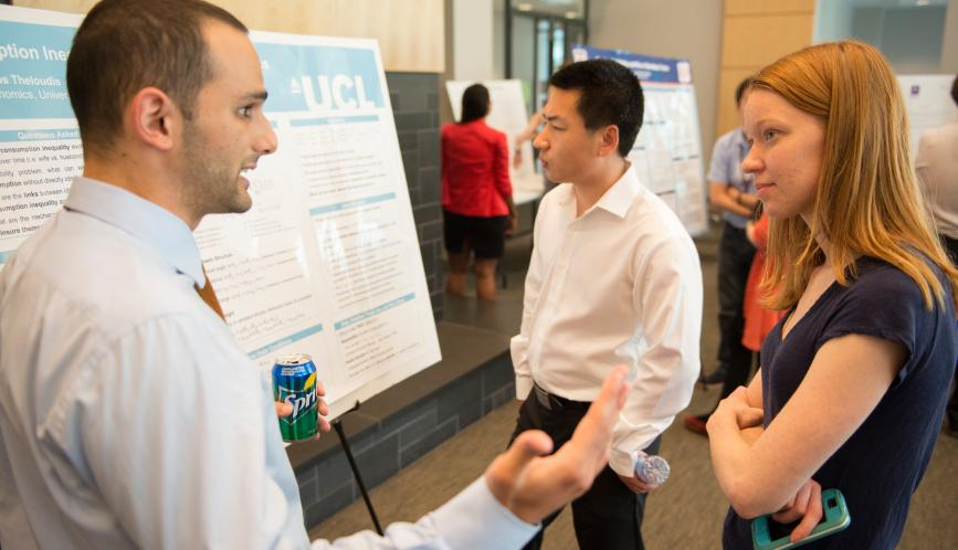 Students in conversation during poster sessions.