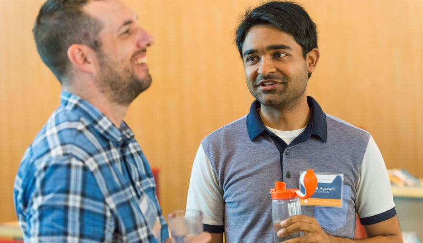Students are able to connect with others who share their research interests in the field. Pictured are Robert Paul Hartley and Mohit Agrawal