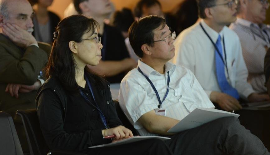 A close up of conference attendees listening to a presentation