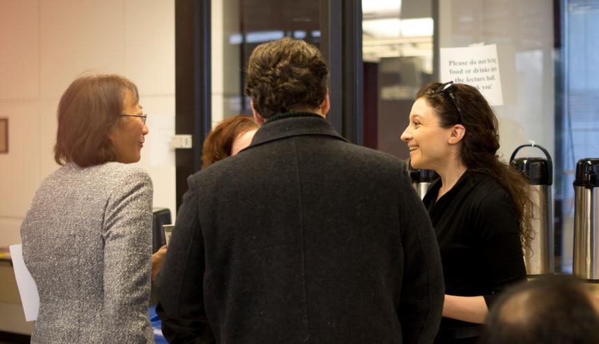 Conference attendees in conversation.