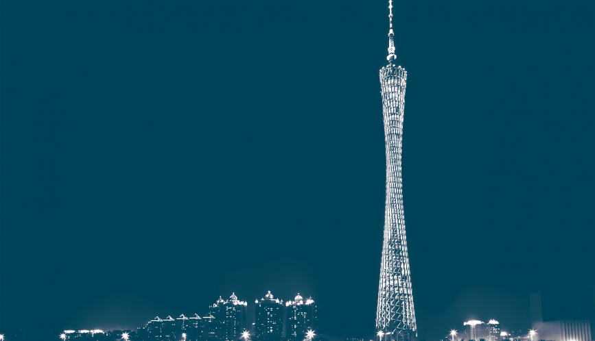 A blue and white image of the skyline in Guangzhou, including Canton Tower.
