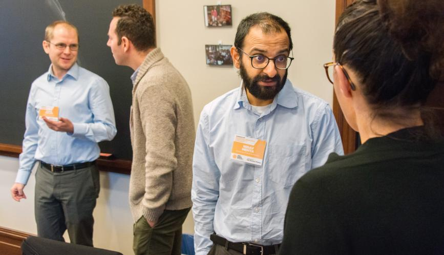 Conference attendees in conversation during a break in the program.