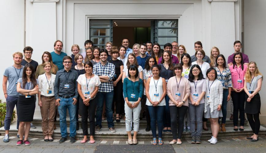 A group image of all the summer school students and faculty, standing outside the briq building.
