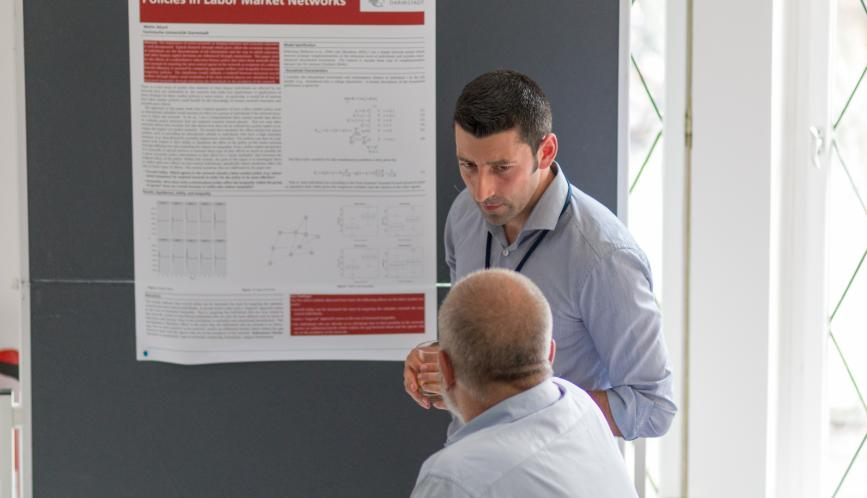 A student presents his work during poster sessions.