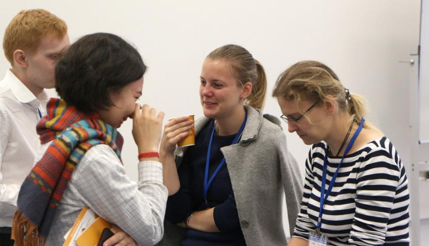 A group of summer school students in conversation during a break.