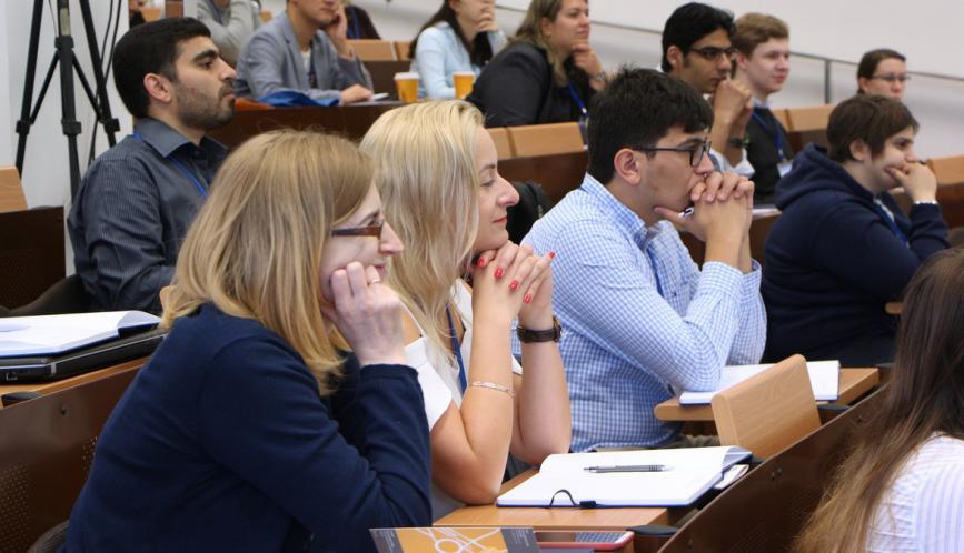 Summer school students watching a presentation.