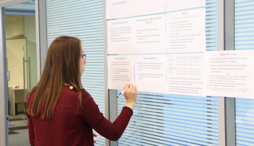 A summer school student during poster sessions.