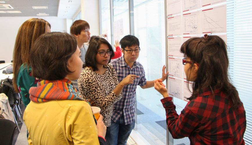 A student presents their work during poster sessions.