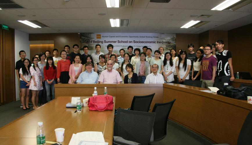 Indoor group photo of all the summer school students and faculty.