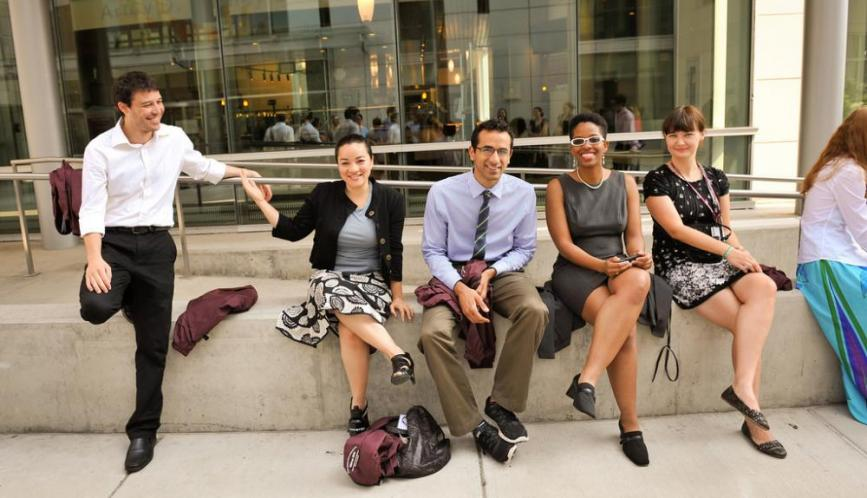 A group of summer school students outdoors and smiling.