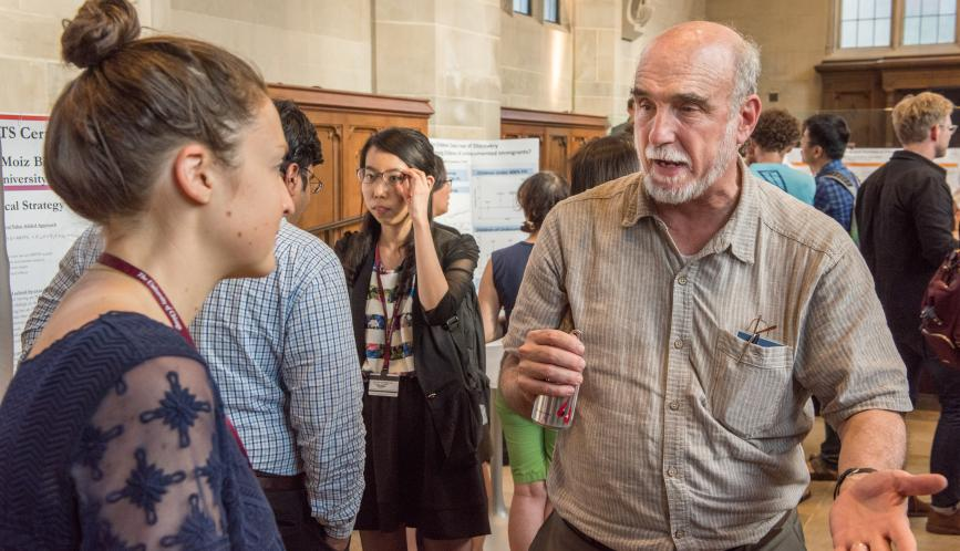 Larry Blume in conversation with a student during poster sessions.