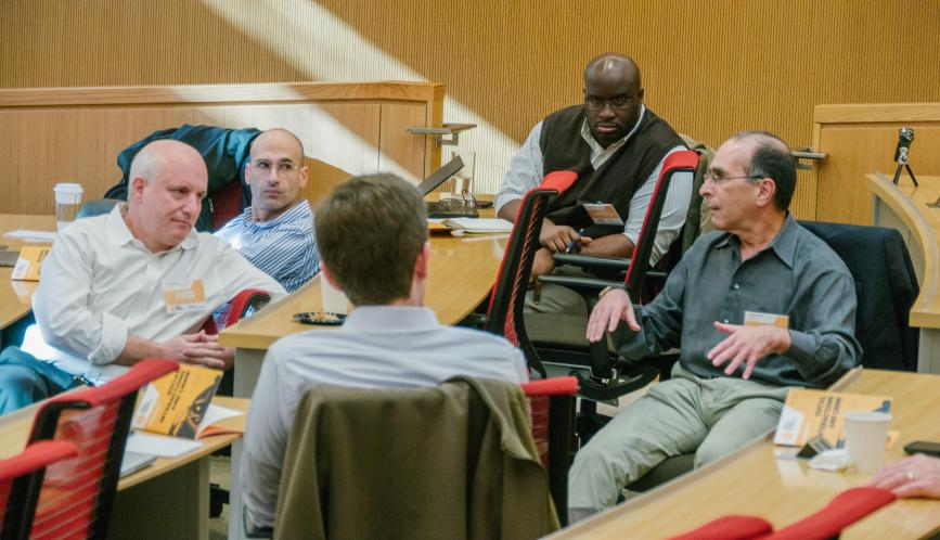 Conference participants in conversation in the classroom.