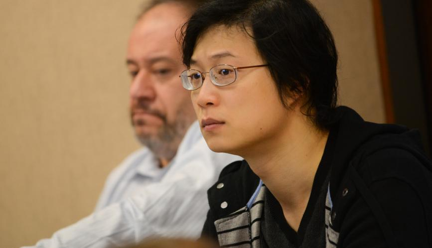 A conference attendee listening to a presentation.