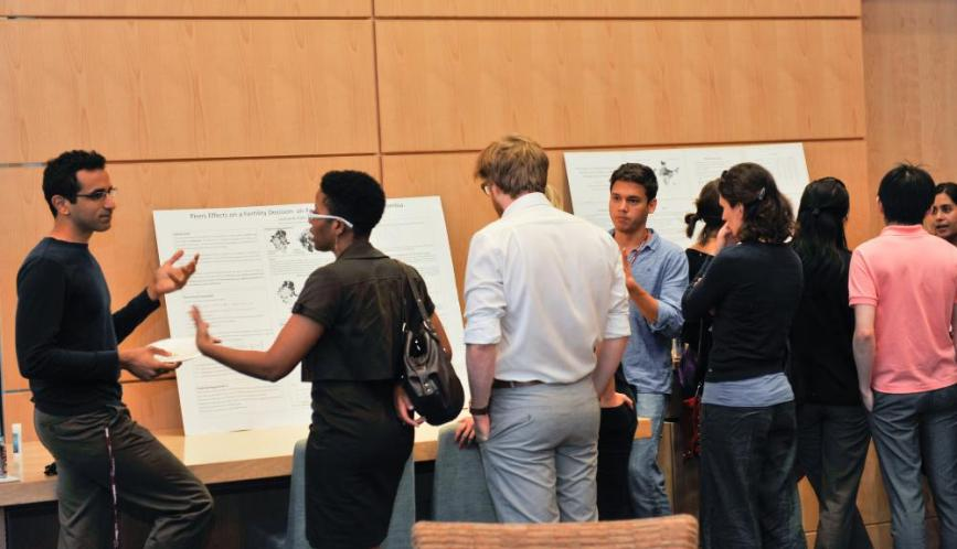 A group of students in conversation during poster sessions.