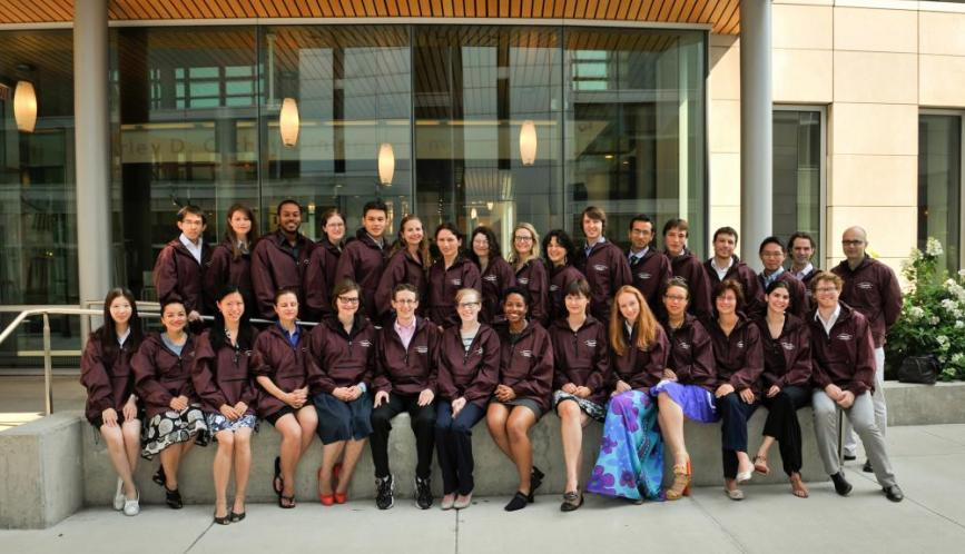 A group shot of all the students and lecturers of summer school, wearing matching jackets.
