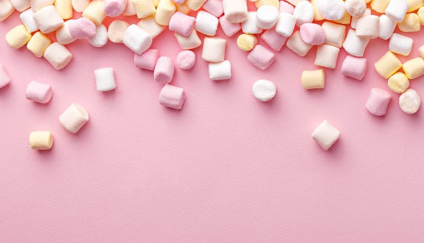 Marshmallows on pink background.