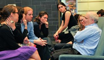 Steven Durlauf, seated, and speaking to a group of students.