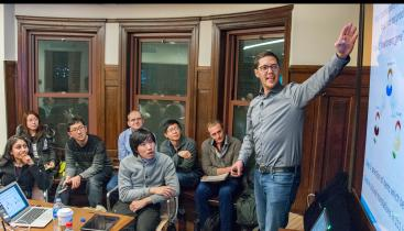Professor Fabian Kosse lecturing to a group of students.