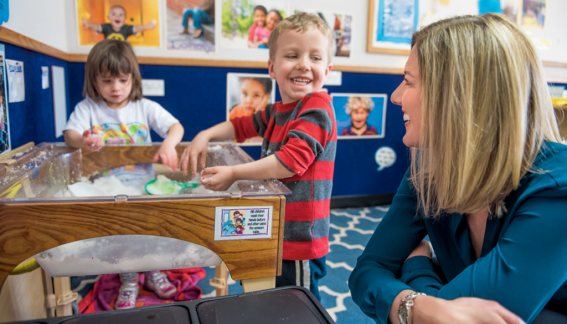 Professor Stephanie Carlson with two young children playing.